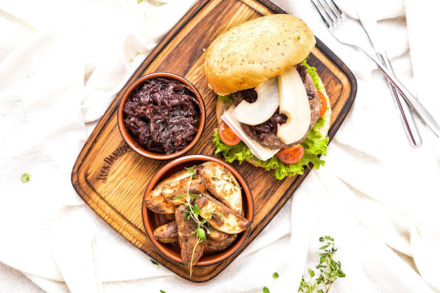 Exquisite beef burger with marinated pear and red onion marmalade