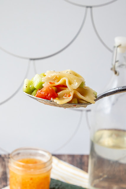 Salad on a spoon with white background