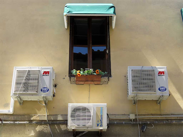 Window with three air conditioner units, via Enrico Mayer, Livorno