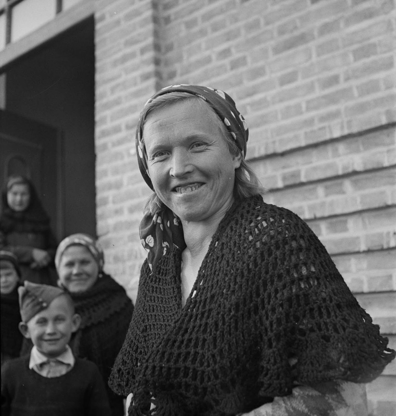 A Polish woman smiling to the camera.