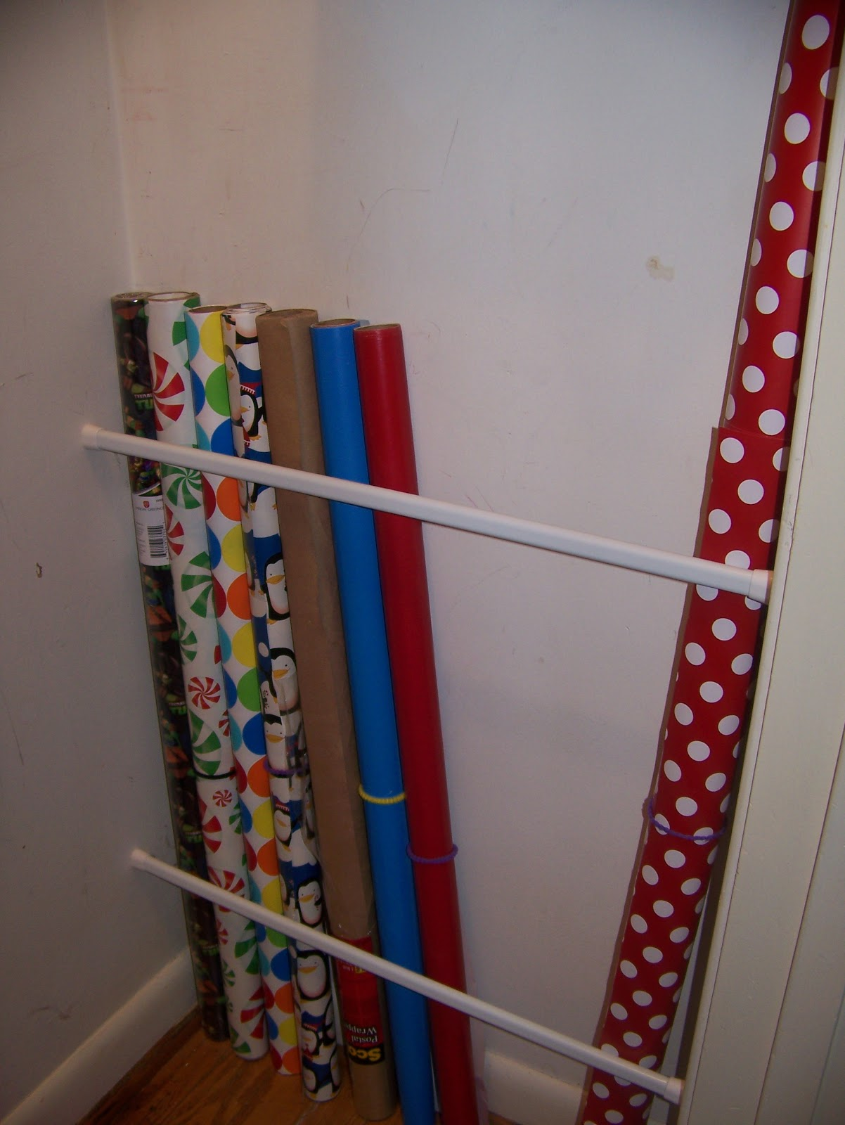 making cooley stuff closet organization easy wrapping paper storage. Black Bedroom Furniture Sets. Home Design Ideas