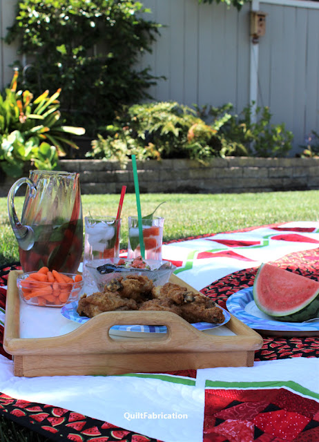 picnic lunch and drinks on Watermelon Delight quilt by QuiltFabrication