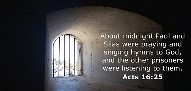 About midnight Paul and Silas were praying and singing hymns to God, and the other prisoners were listening to them.