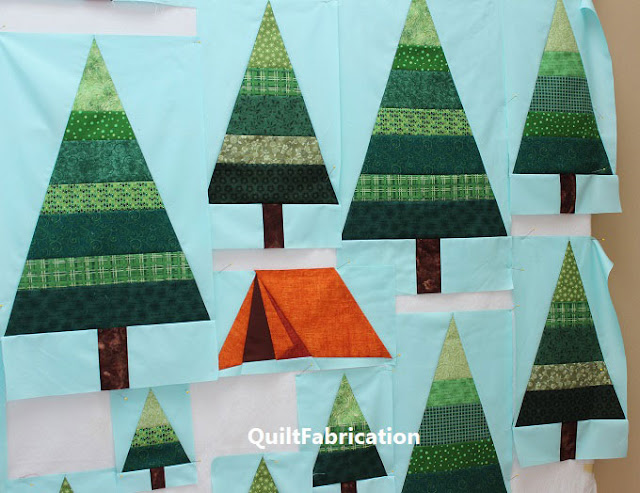 green striped trees on aqua background with an orange tent by QuiltFabrication
