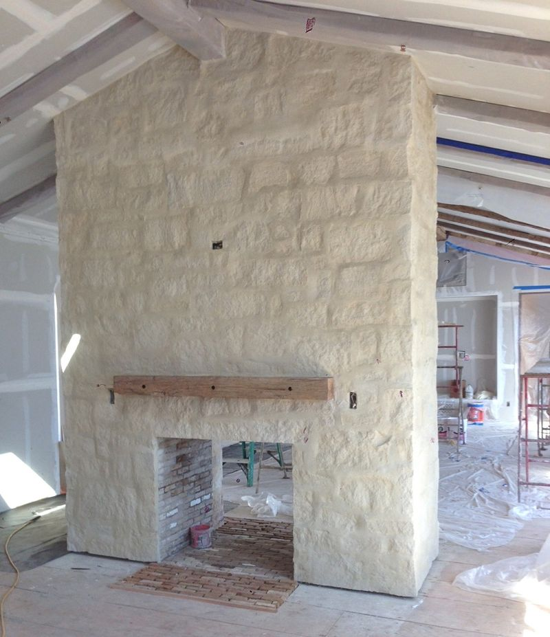 Before pic of Limestone fireplace at #PatinaFarm in kitchen