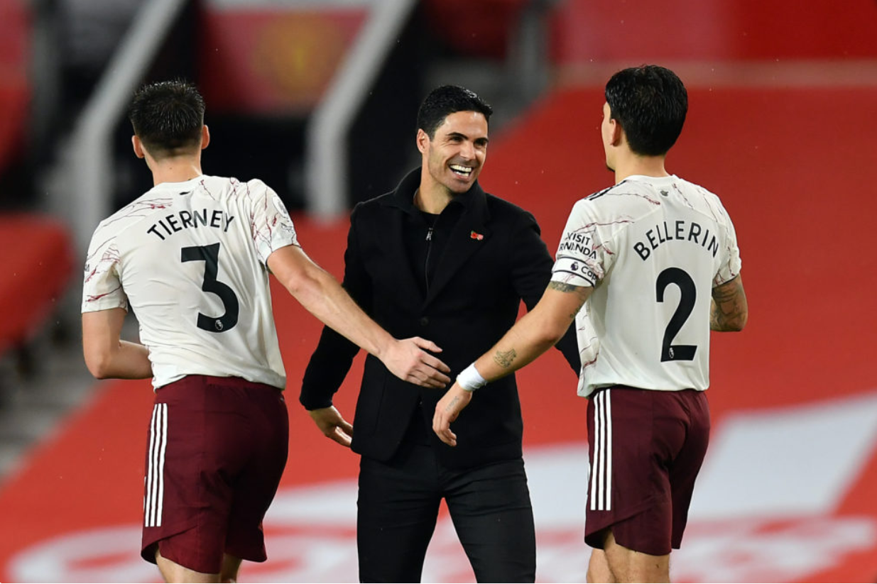 Mikel Arteta celebrates Arsenal's win at Old Trafford with his players