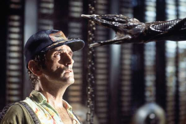 Harry Dean Stanton as Brett and Alien hand