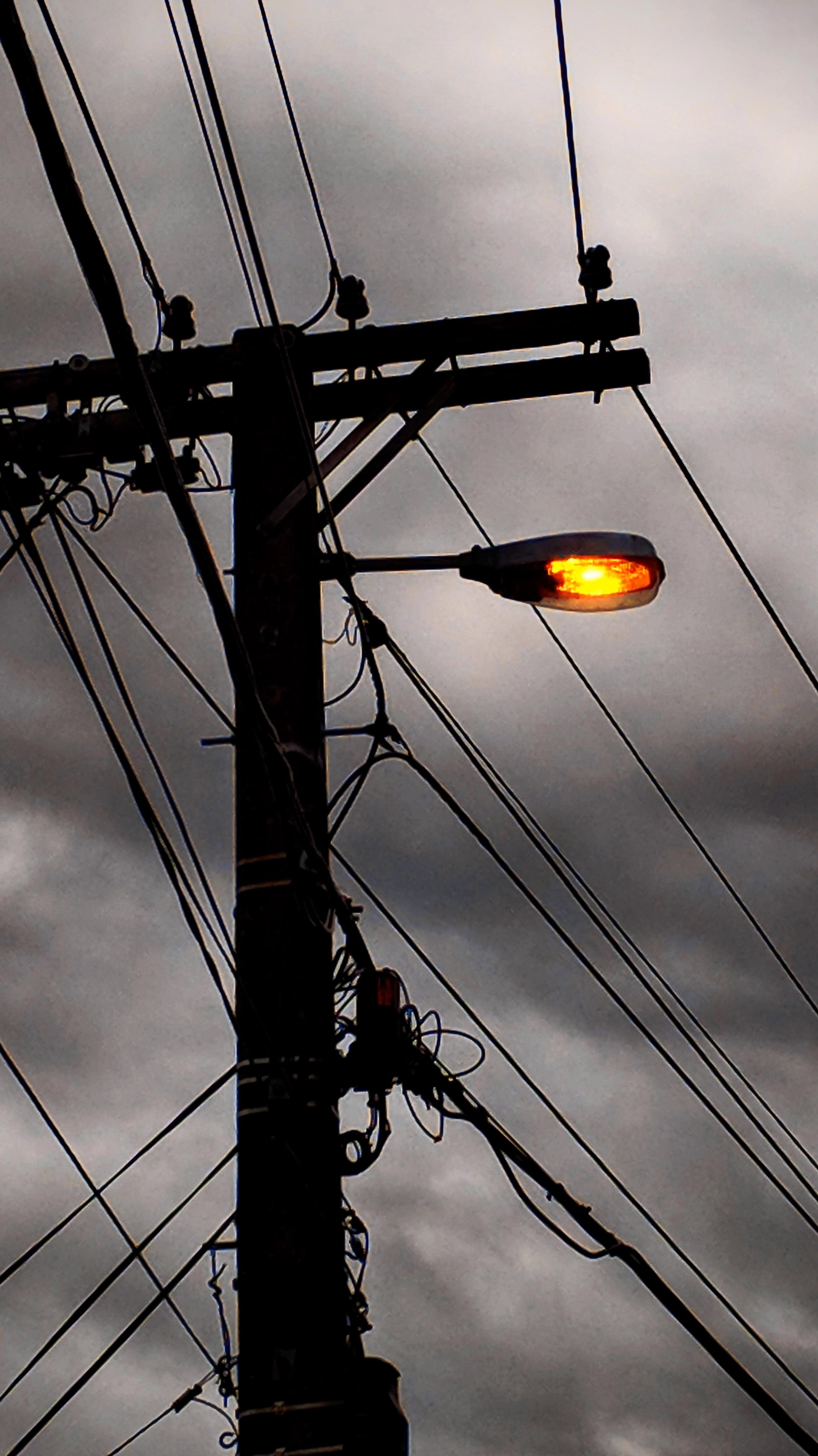 Street light against a dark and stormy sky