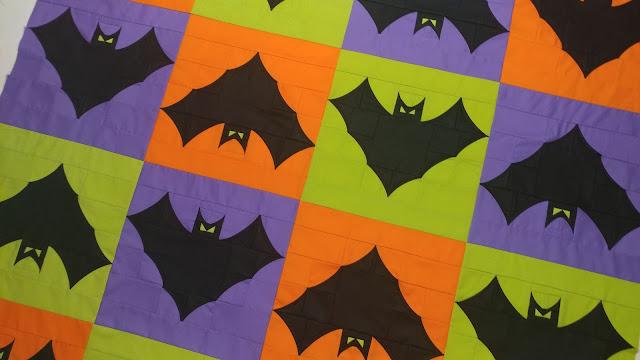 Bat quilt top in orange, lime, purple
