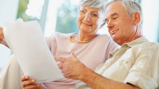 elderly couple looking at paperwork