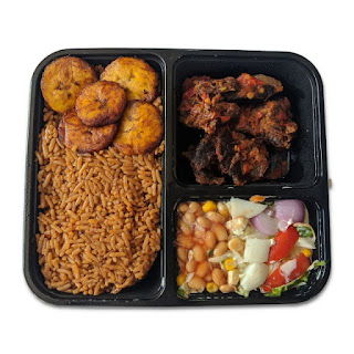 Jollof Rice Served With Plantain and Salad With Beef On A White Background