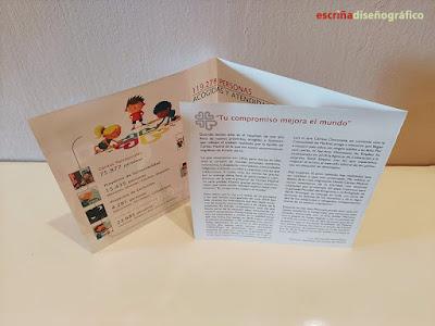 Interior del tríptico de la memoria de actividades de Cáritas Madrid