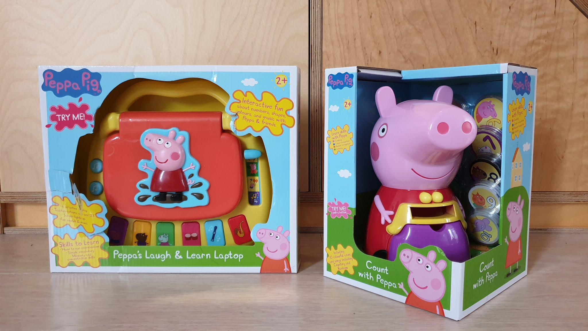 two peppa pig toys in a box