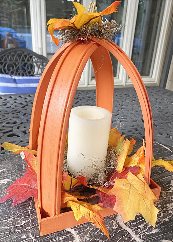 pumpkin lantern on outdoor table