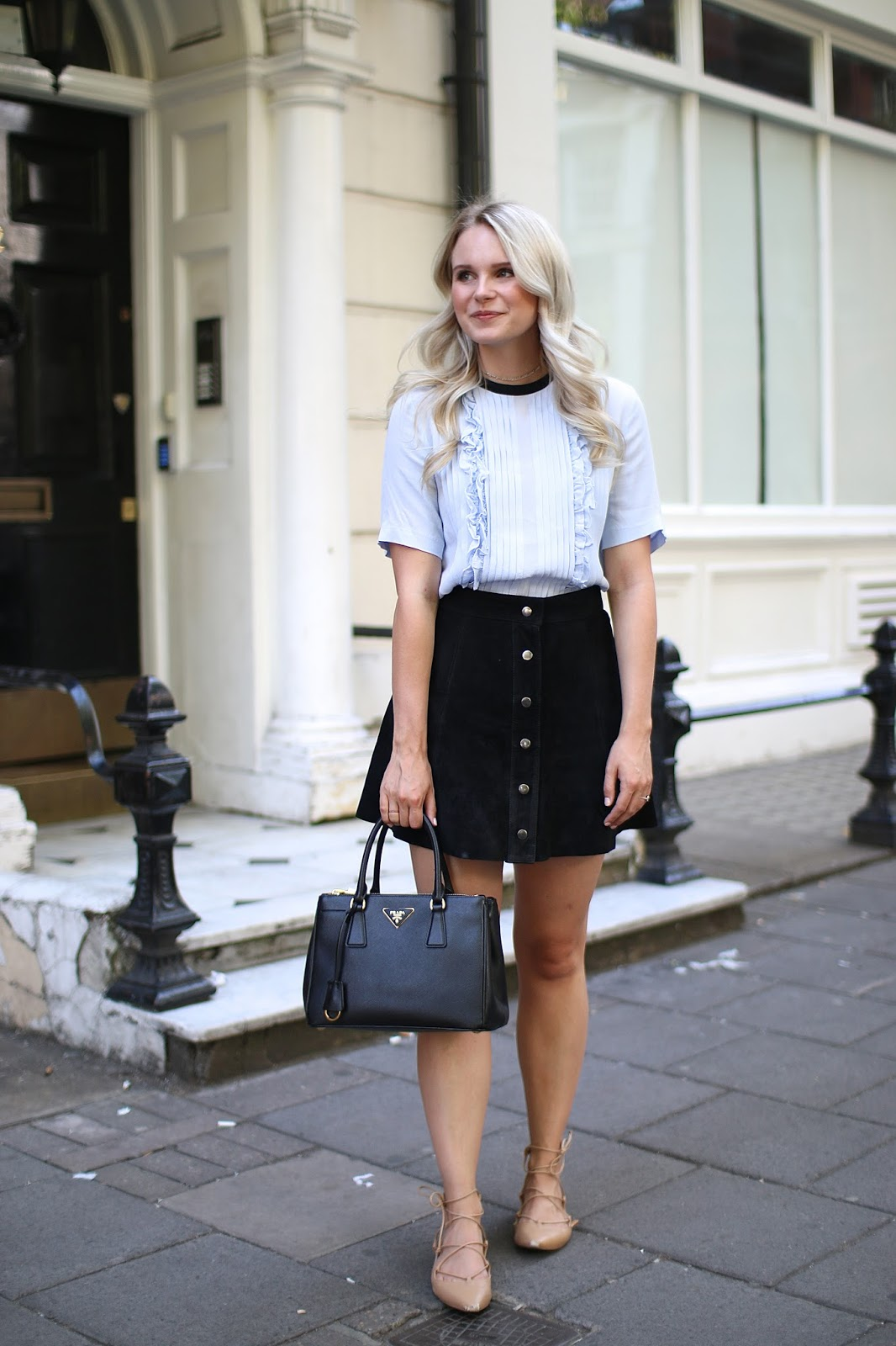 light blue blouse and suede skirt