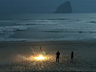 Fourth of July celebrations on the beach in Pacific City - with Haystack Rock in the distance.