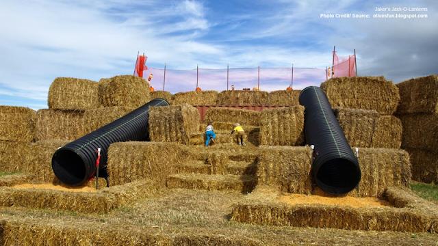 large slides resting on bales of hay