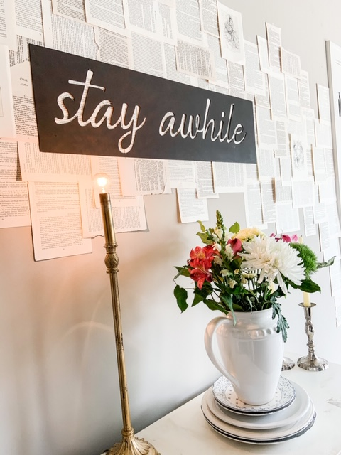 book pages taped on wall as decor