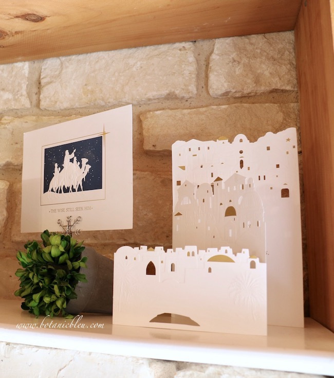Blue O Holy Night shelf decor has a Christmas card with three wisemen on camels underneath a navy sky