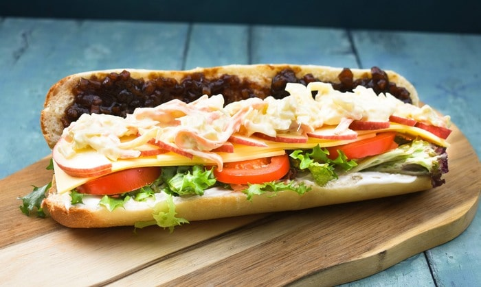 Vegan cheese ploughman's sandwich on a wooden board