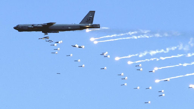Image Attribute: A B-52 Stratofortress from the 2d Bomb Wing at Barksdale Air Force Base, La., drops live ordnance over the Nevada Test and Training Range near here May 12 during an Air Force firepower demonstration. The demonstration showcases the Air Force's air and space capabilities. / Source: the United States Air Force photo by Senior Airman Brian Ferguson (Wikimedia Commons)