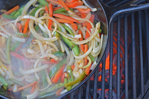 Cooking peppers and onions in cast iron skillet on the Big Green Egg