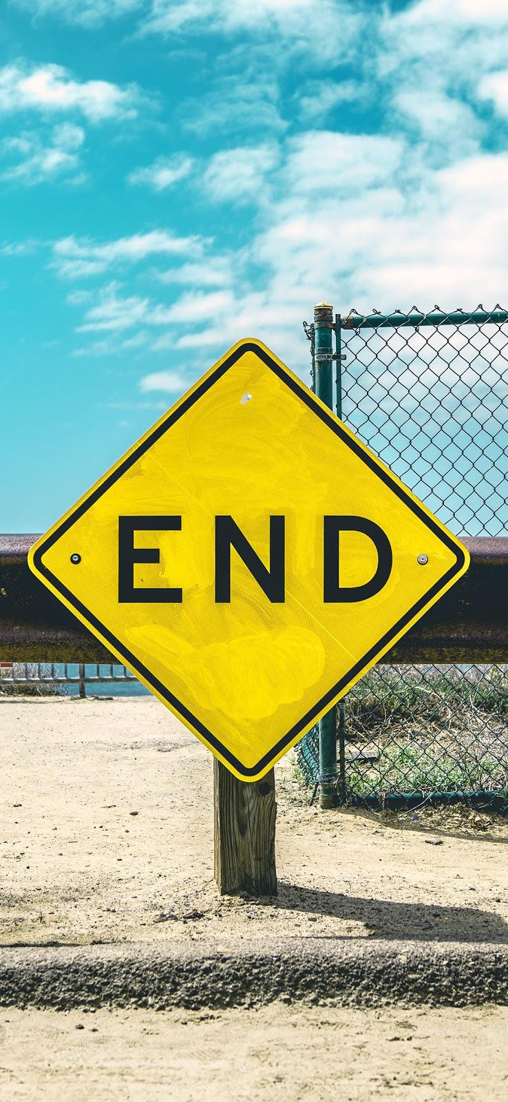 End sign on beige sand wallpaper