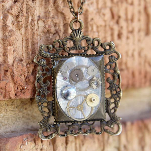 steampunk gears and cogs set in ornate pendant with jewelry resin
