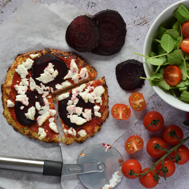 Cauliflower crust pizza topped with roasted beetroot and goats' cheese