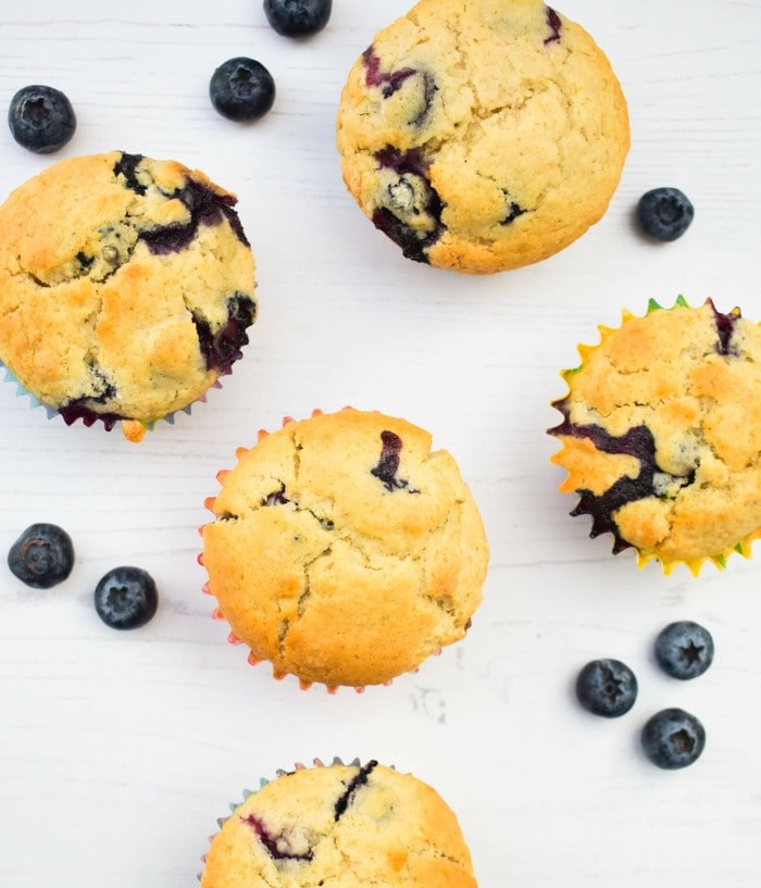 overhead shot of blueberry ginger muffins and blueberries