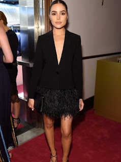 Olivia Culpo in a black blazer dress with a ostrich feather detail at the 2016 CFDA Fashion Awards