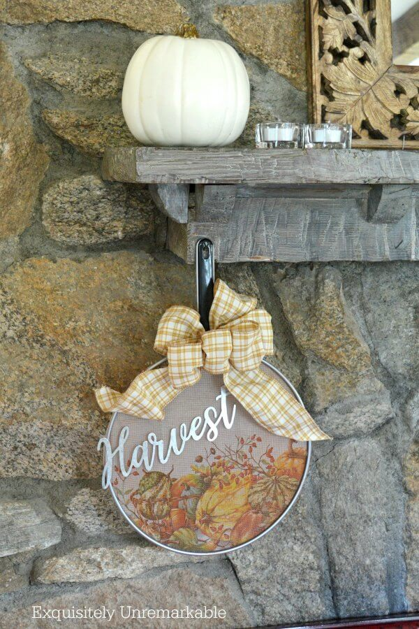 Splatter Screen Wreath on a stone fireplace with pumpkin on mantle