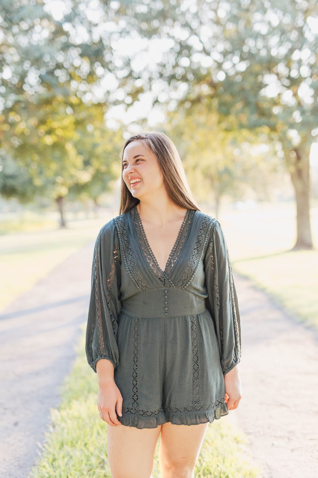 Brunette girl wearing dark forest green long sleeve lace american eagle romper at camp milton preserve in jacksonville florida
