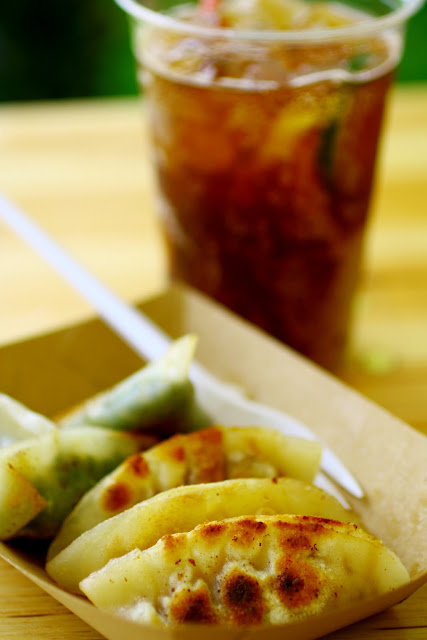 Foodies Festival, Syon Park - gyoza from The Ugly Dumplings teamed with alcoholic ice tea from Harry Brompton's