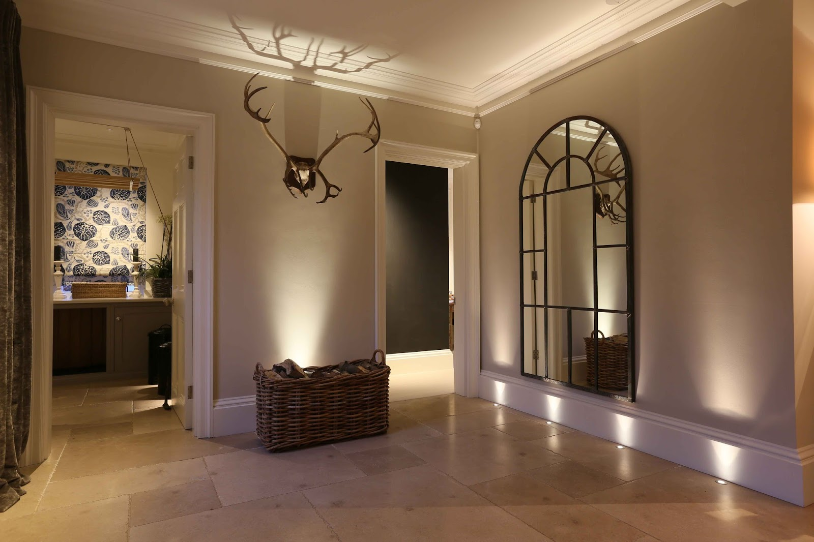 wall washing lighting in a low ceilinged room or basement introducing uplighting and wall washing increases ceiling up lighting