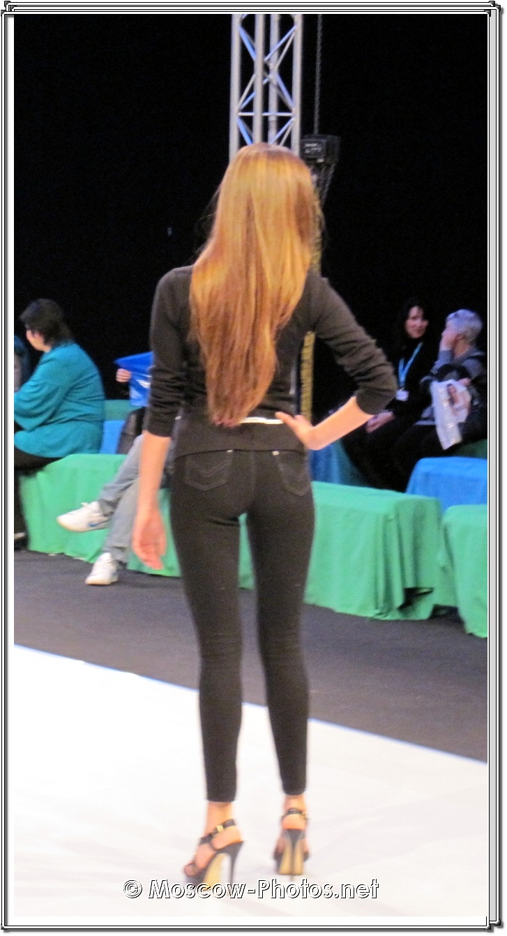 Long-Haired Girl In Black Jeans On High Heels