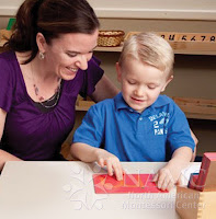 best advice to a new NAMC montessori teacher from other teachers helping child with sandpaper letters