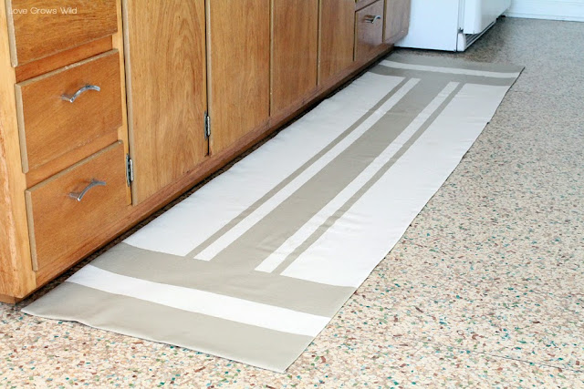 How to Make a Rug from a Drop Cloth! You can make any color, pattern, shape, or size you want for WAY less than purchasing a rug!