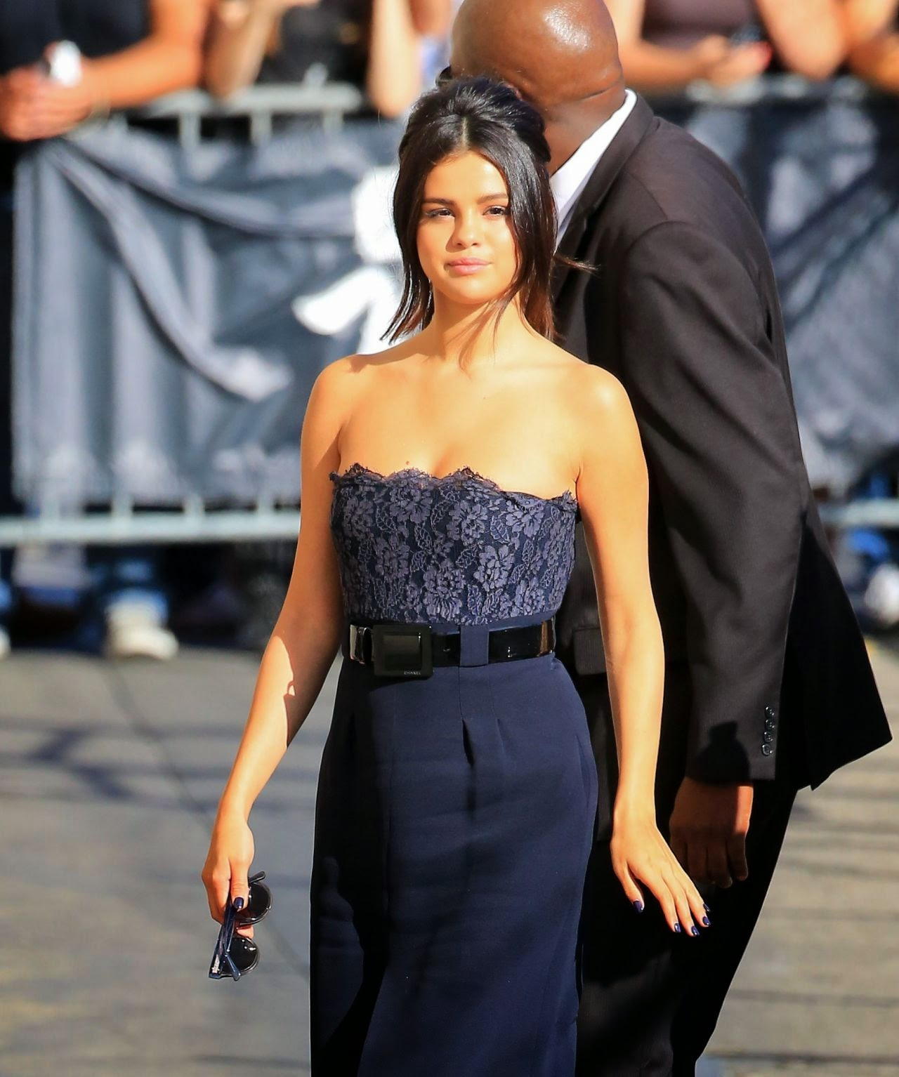 Selena Gomez arrives at Jimmy Kimmel Live in a strapless navy dress