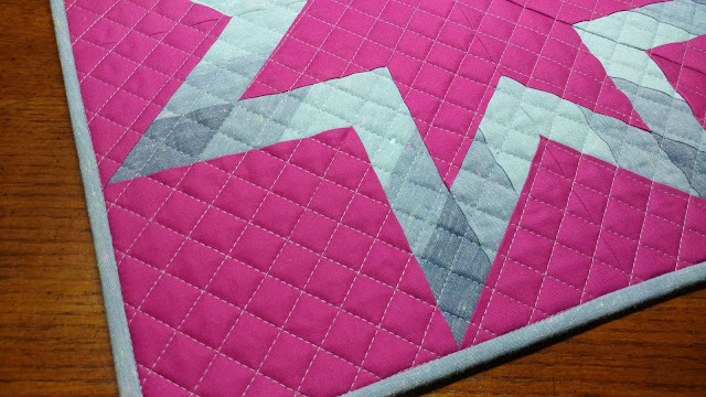 Cross-hatch quilting on star quilt