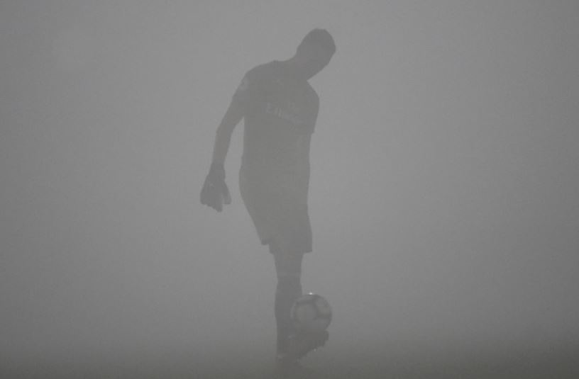Footballer-enveloped-in-smog
