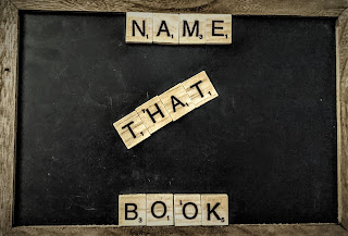 "A chalk board with Scrabble tiles that spell out: ""Name That Book"""