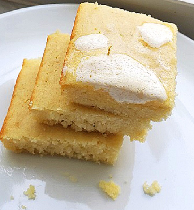this is a triple stack of homemade cornbread with butter on top