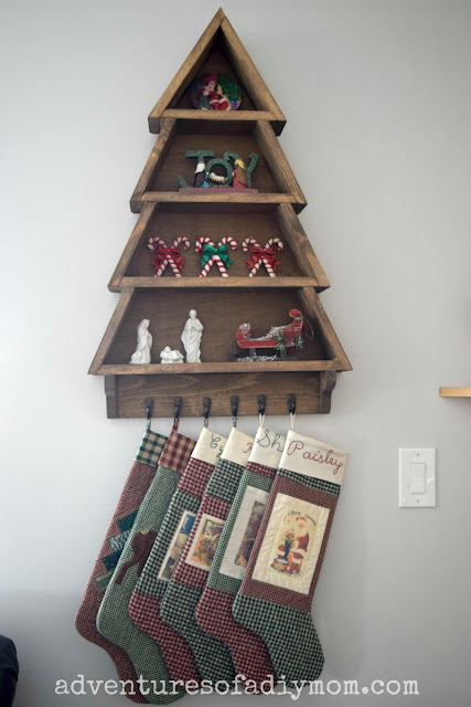 Christmas tree shelf with stockings