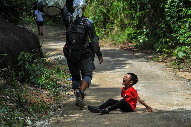 series photo of uncooperative boy during trekking trip