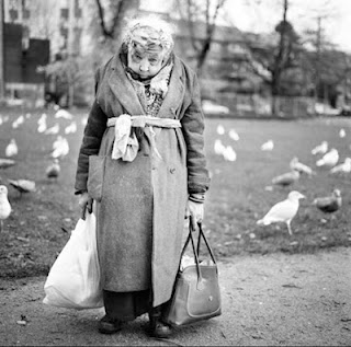 'bag lady' in the park - pay for carrier bags