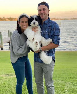 Justin Thomas And His Girlfriend Jillian Wisniewski With Their Sheepodoodle