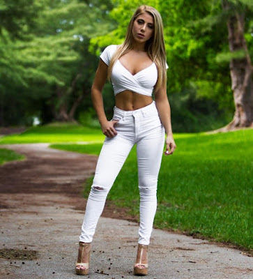 Valeria Orsini in white pants