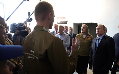 Russian President meeting with members of a student construction brigade.