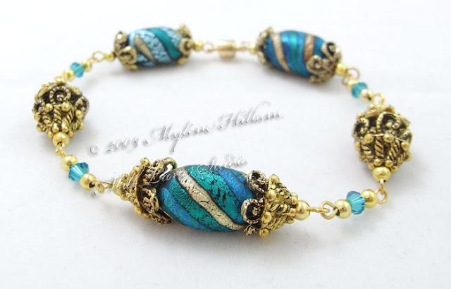 Friendly Plastic twist bead bracelet with multi-layered bead cap beads.